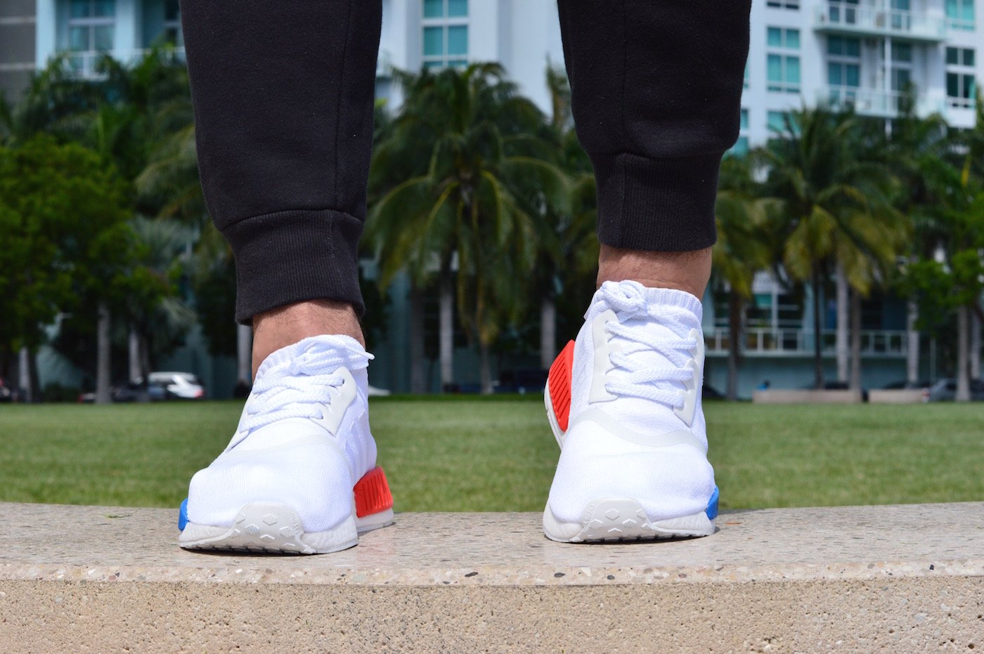 adidas NMD R1 Primeknit On Feet Front View White Red Blue