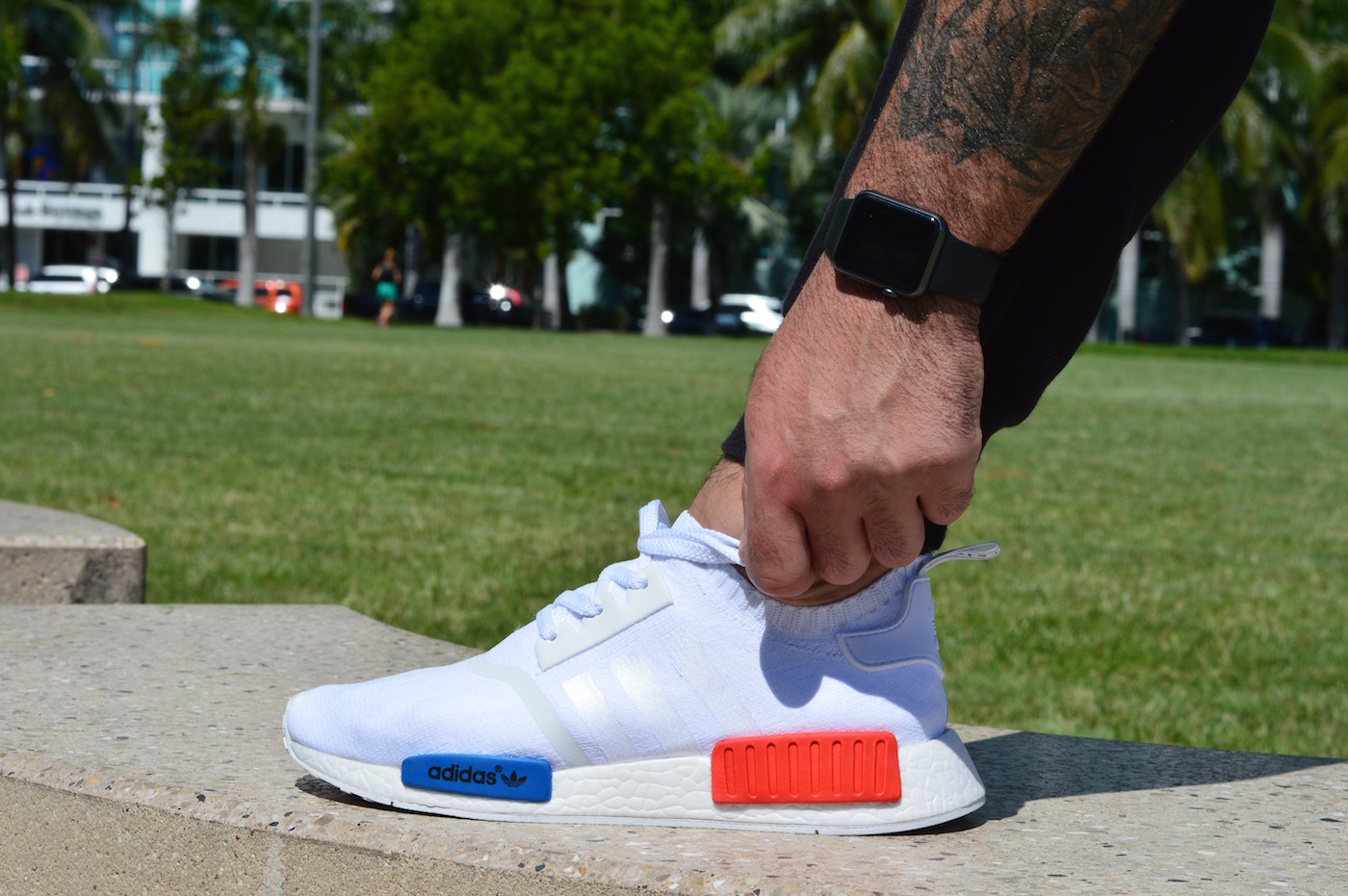 adidas NMD R1 Primeknit On Feet Side View White Red Blue