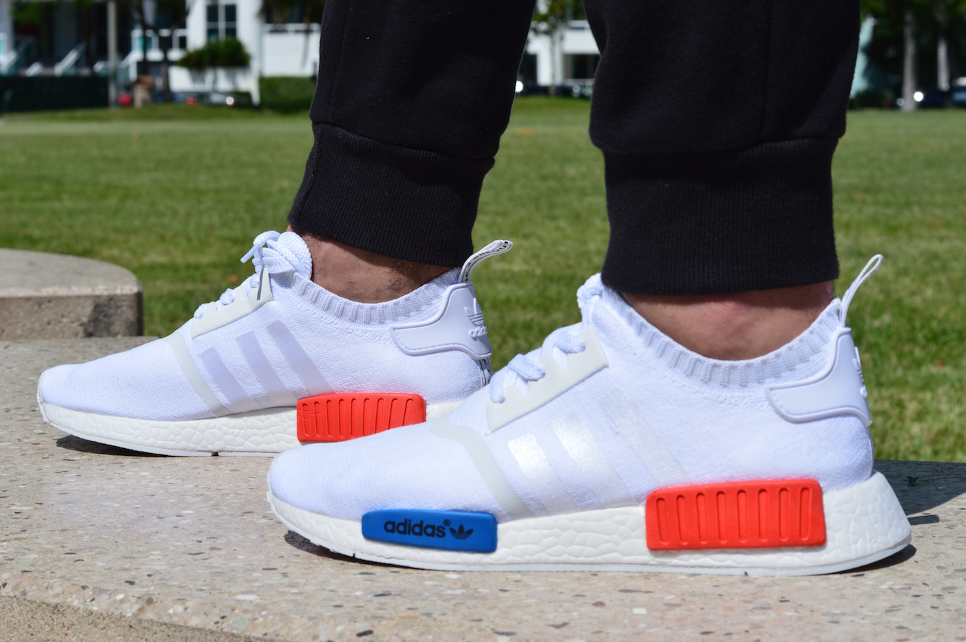 adidas NMD R1 Primeknit On Feet 2 Feet Side View White Red Blue