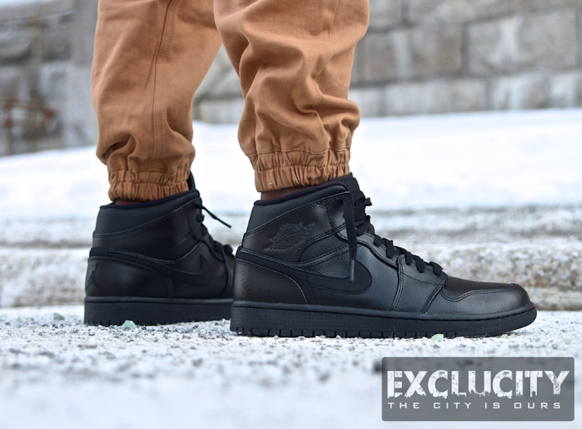 cheap for discount 88f93 f1c68 Triple Black Jordan 1 Mid on Feet